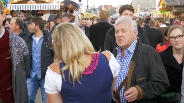 People in national Bavarian suits on the street of Oktoberfest festival. Bavaria, Slow Motion