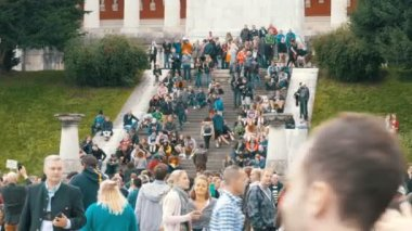 Crowd of People are walking on the steps near the statue of Bavaria. Oktoberfest festival. Germany