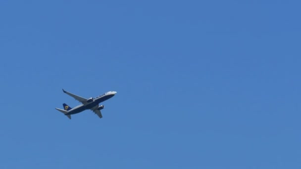 The Passenger Airplane is Flying Far in the Blue Sky