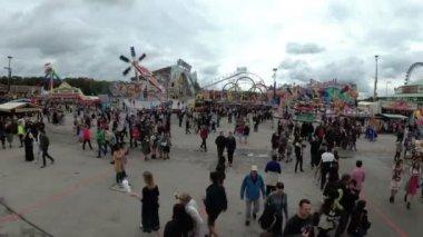Crowd of People celebration on central street of the Oktoberfest festival. Bavaria, Germany