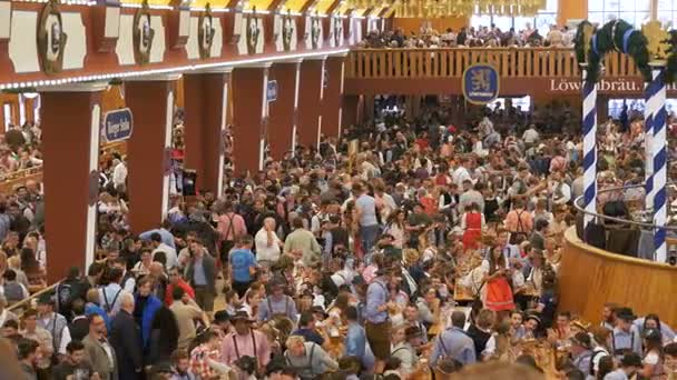 Celebration of Oktoberfest inside large beer tent. Bavaria, Germany