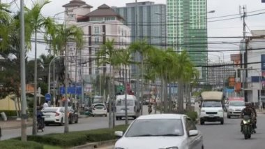 Asian Road Traffic in Pattaya Street with Palm trees, Thailand