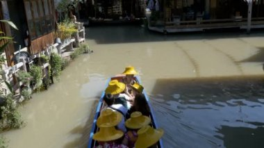 Pattaya Floating Market. Small Tourist Wooden Boat moving along the water. Thailand