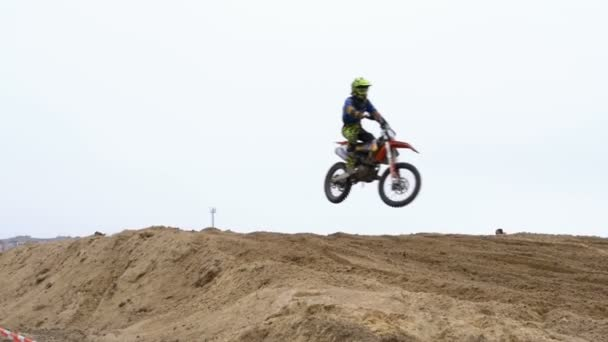 Motocross. Riders jumping. Off-road racing on enduro bikes. Slow motion