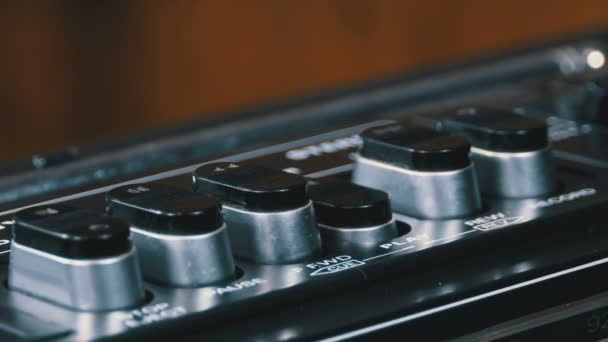 Pushing Button on a Tape Recorder, Play, Stop, Rec, ff, Rew