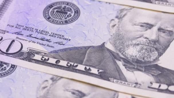 Pomalé otáčení padesát dolarů americké bankovky. Pozadí s penězi