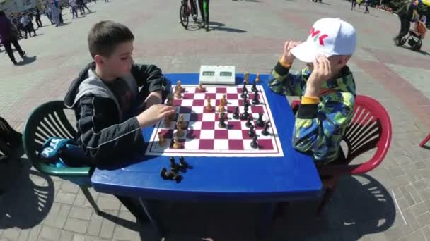 Chessboard and figures. Competitions in checkers among children