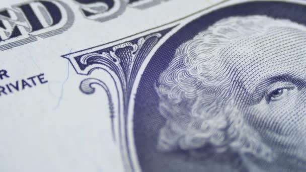 Pomalé otáčení George Washington portrét na jednodolarové bankovce