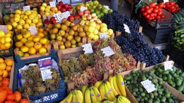 Showcase with Various Fruits, Persimmons, Tangerines, Pears and more in the Street Market