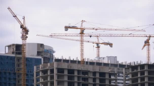 Tower Cranes on a Construction Site at High-rise Building under Counstruction