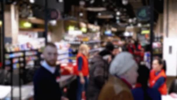 Crowd of Buyers in a Supermarket Stand in Line at the Checkout