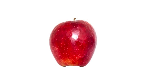 Creative 4k stop motion video of a green and red apple close-up, quickly flickering in turn on an isolated white background. Seamless loop.