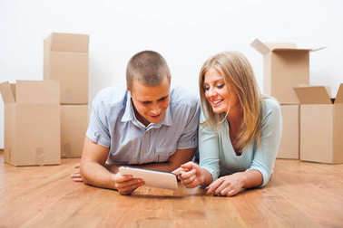 Young couple is moving in their new home.