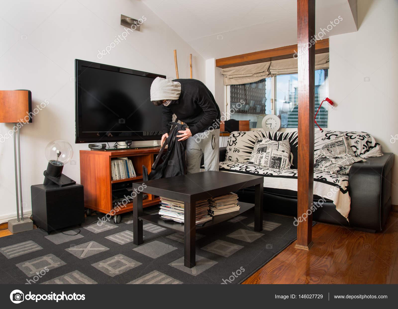 burgler robbing a house stock photo studiof22byricardorocha