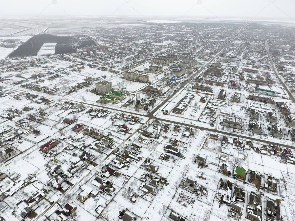 Winter view from the bird's eye view of the village. The streets are covered with snow.