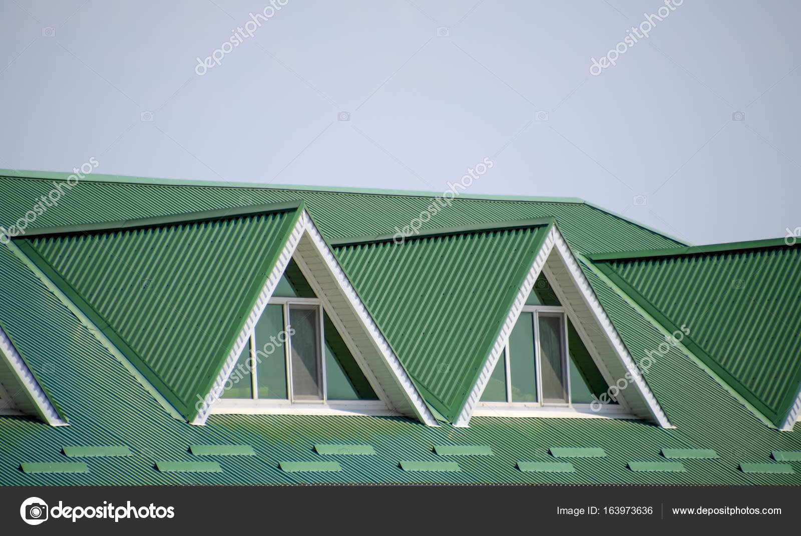 The house with plastic windows and a green roof of corrugated roofing of metal profile wavy shape on the house with plastic windows green roof of corrugated metal profile and plastic sciox Image collections