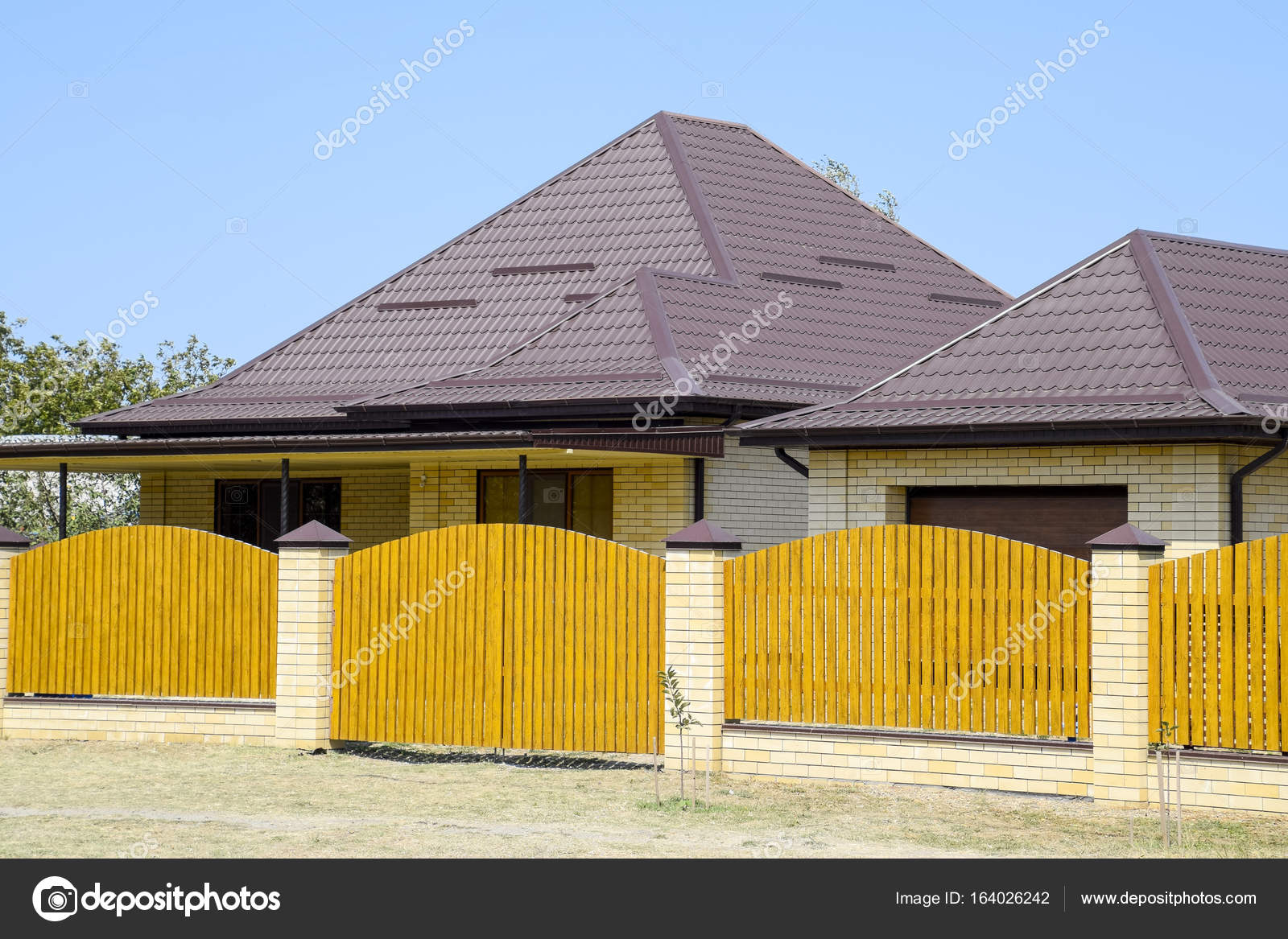Brick House With Corrugated Metal Profile Roof And Wooden Fence Beautiful View Of The Facade Style Of Design P O By Leonid_eremeychuk