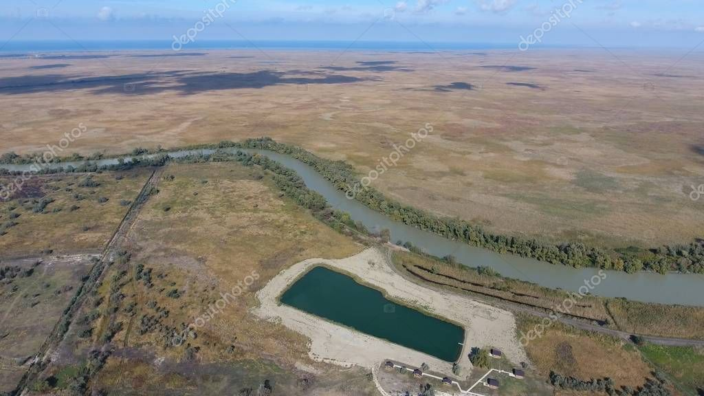 Landscape near the Sea of Azov, the river, an artificial lake and open spaces for hunting and fishing