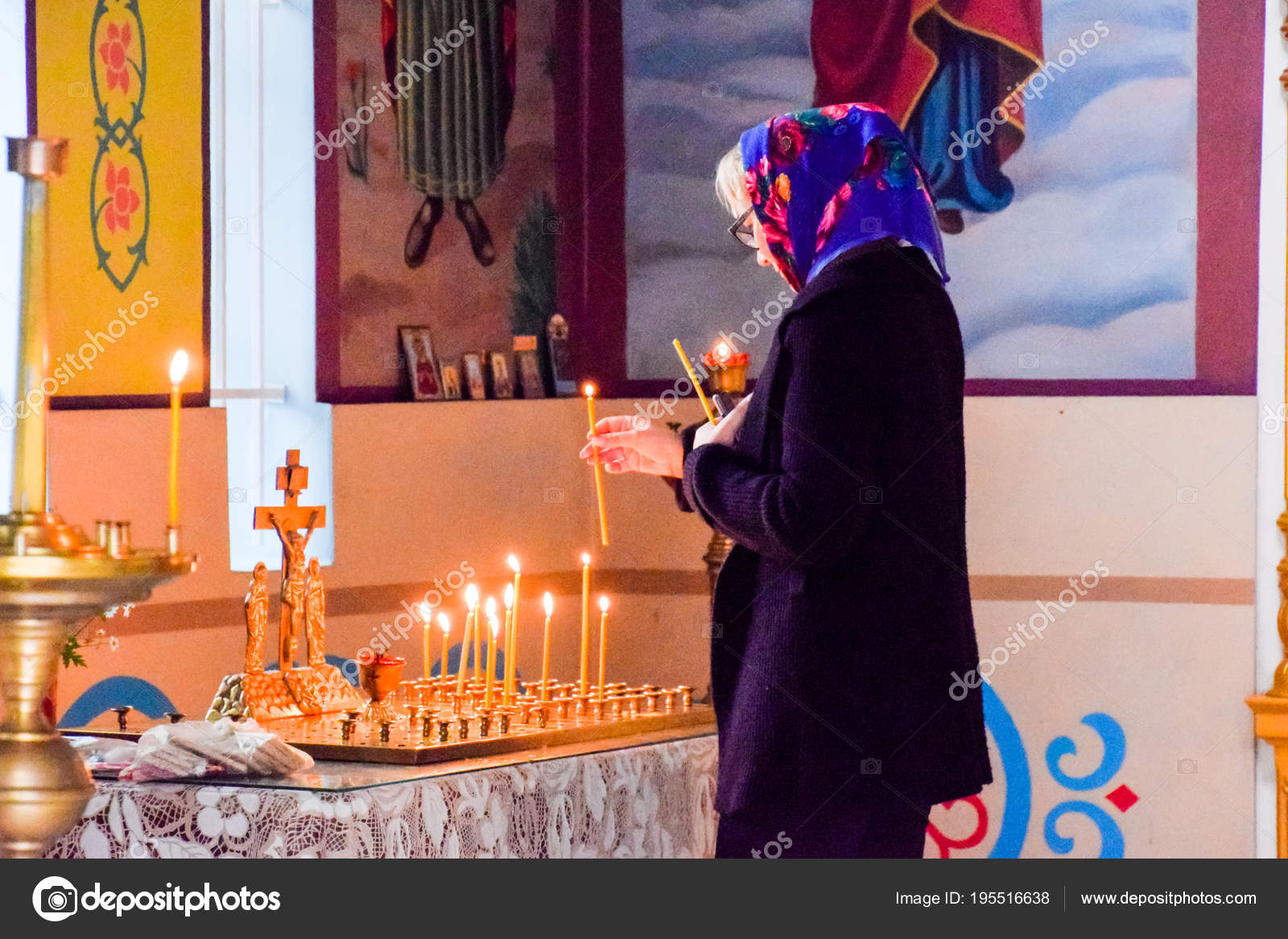 A praying woman in an Orthodox Christian church in the village of