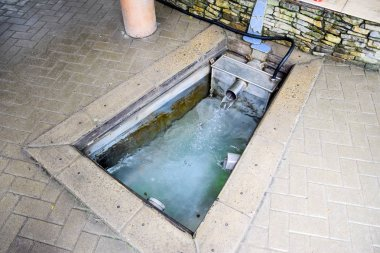A small swimming pool with holy water from the spring. A niche in the floor for recruiting water from a source