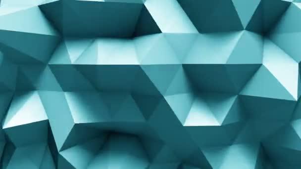 modrá polygonální geometrického povrchu. počítač tvořil pozadí abstraktní pohybu bezešvé smyčka.