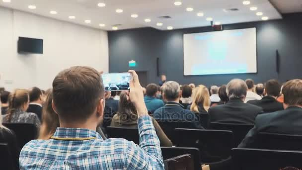 people at a conference or presentation