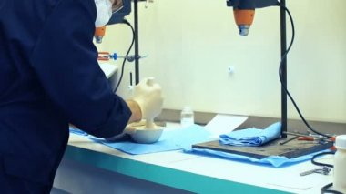 Junior pharmacist mixing a medicine in the hospital pharmacy
