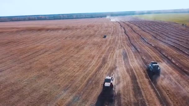 aerial footage of a modern tractor plowing dry field, preparing land for sowing. seeding at the end of the season. Plant new grains for the next year.