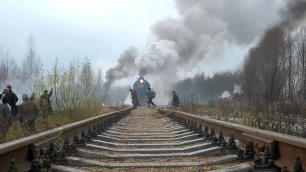MOSCOW RUSSIA - 09.11.2019: An old Soviet steam train moves on rails during World War II. Evacuates the local civilian population. Soldiers of the red army on guard of the civilian population