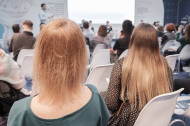 Business woman and people Listening on The Conference. Horizontal Image