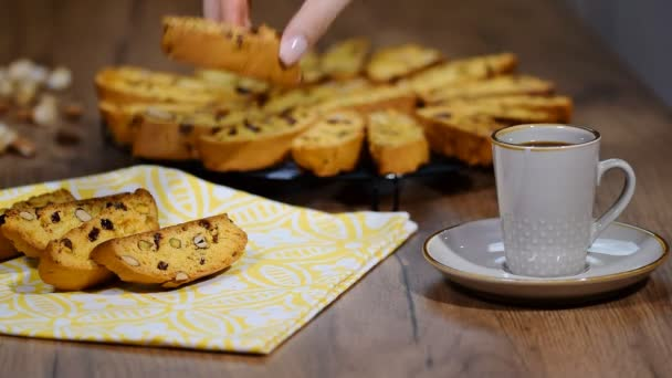 Cup of black coffee and cantuccini