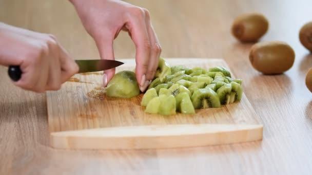 Cutting a kiwi fruit, close-up.