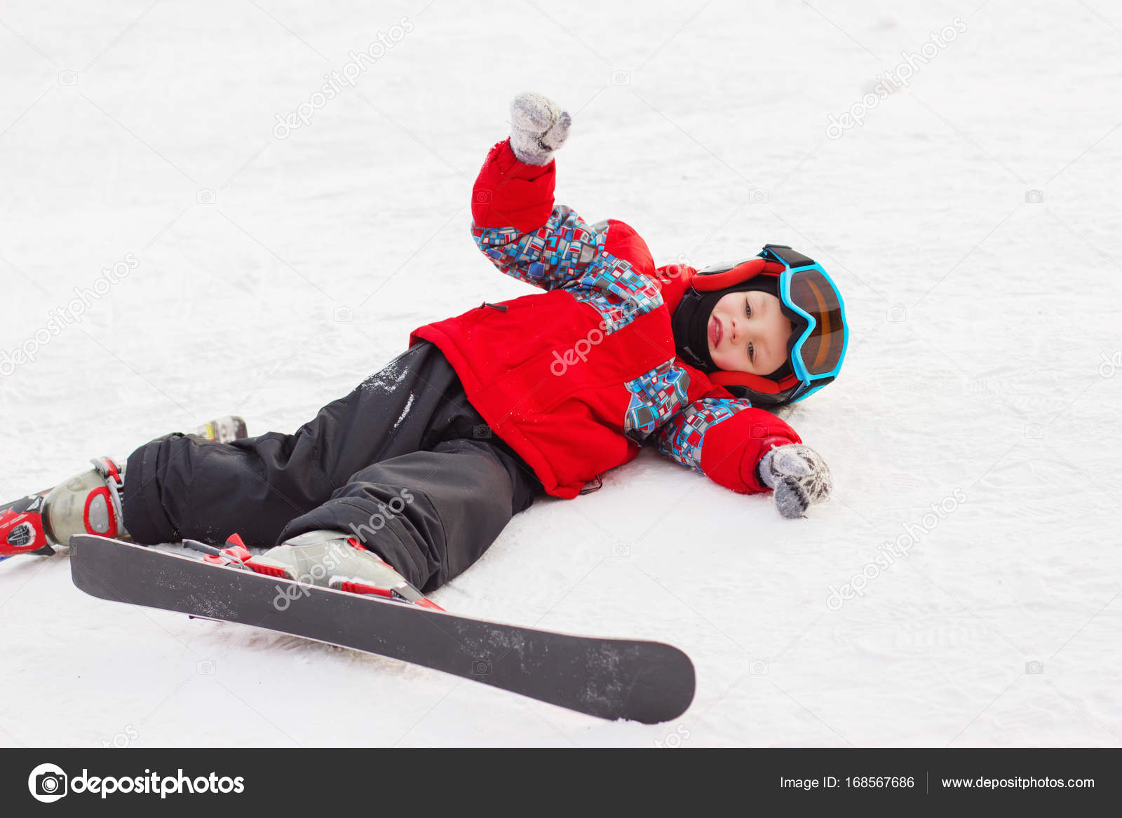 7dbdb65725d9 Little cute boy with skis and a ski outfit. Little skier in the ...