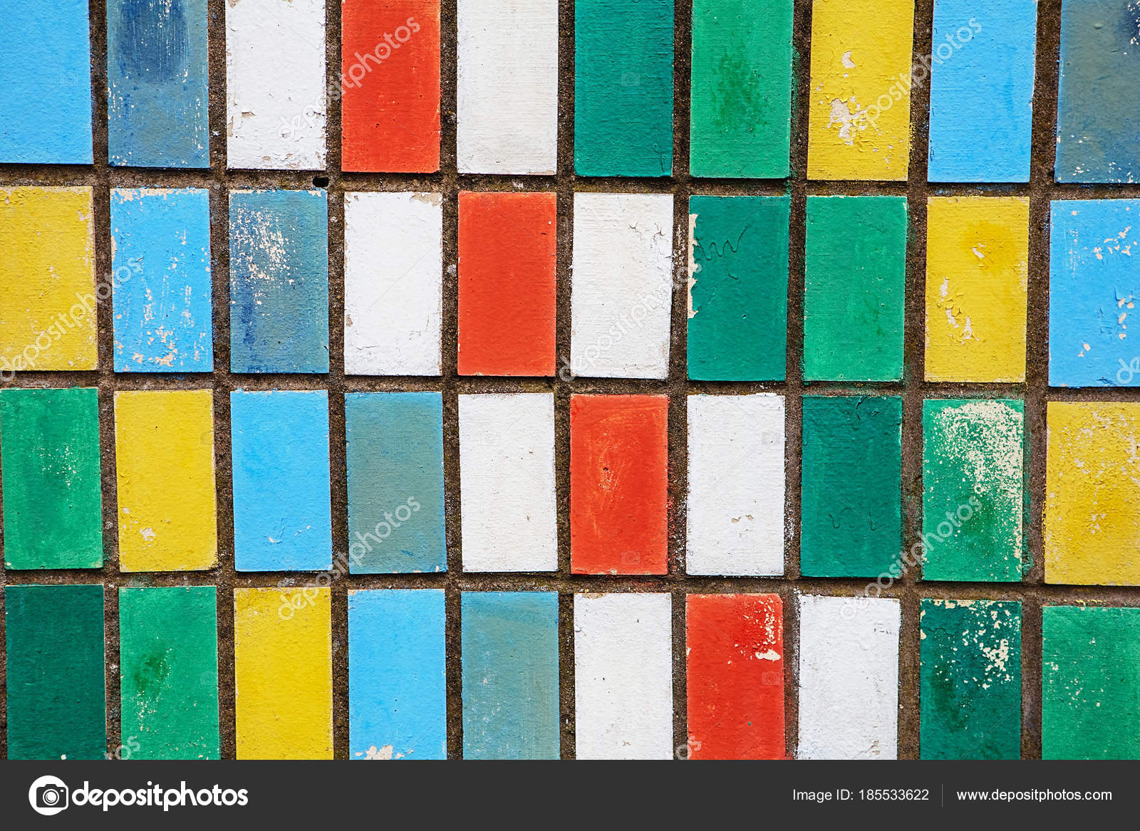 texture of old wall tiles with peeling bright paint. colorful ol ...