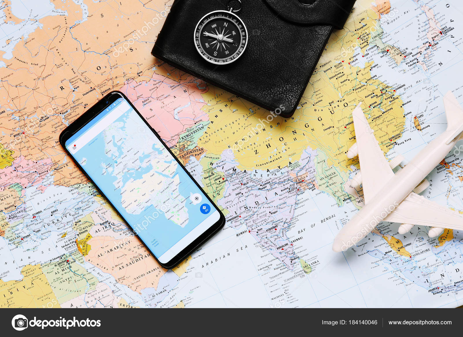 Compass toy airplane mobile phone world map background stock photo compass toy airplane mobile phone world map background stock photo gumiabroncs Images