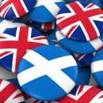 Scotland and UK Badges Background - Pile of Scottish and British Flag Buttons 3D Illustration Стоковое Изображение