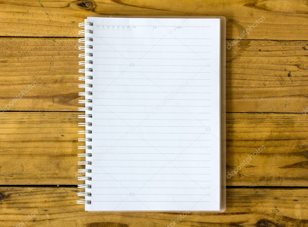 a blank notebook page on table wood office notebook top view for design and background photo by asaneephoto