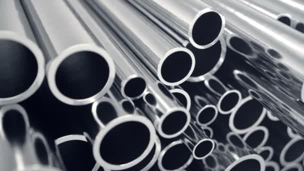 Industrie-Business-Produktion und schwermetallurgische Industrieprodukte, viele glänzende Stahlrohre, industrieller Hintergrund, Fertigung Business-Produktionskonzept mit selektiver Fokuseffekt. 4k 3D