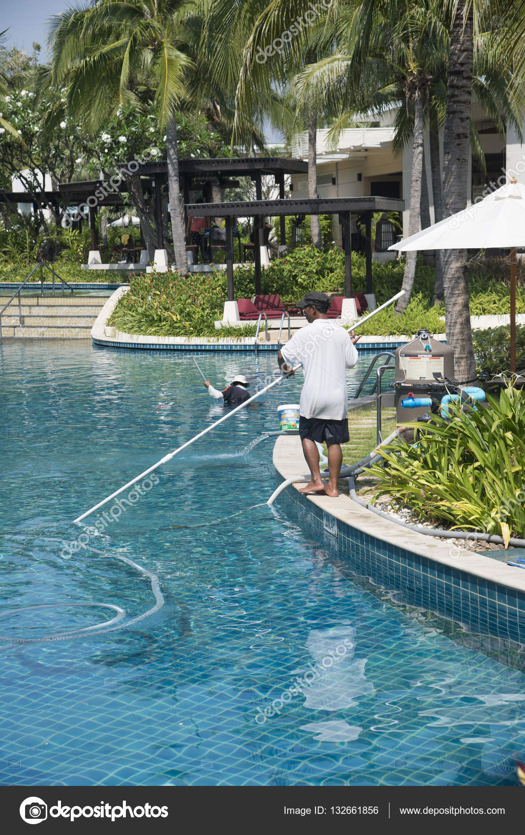Hotel workers cleaning a swimming pool. Thailand 2014 ...