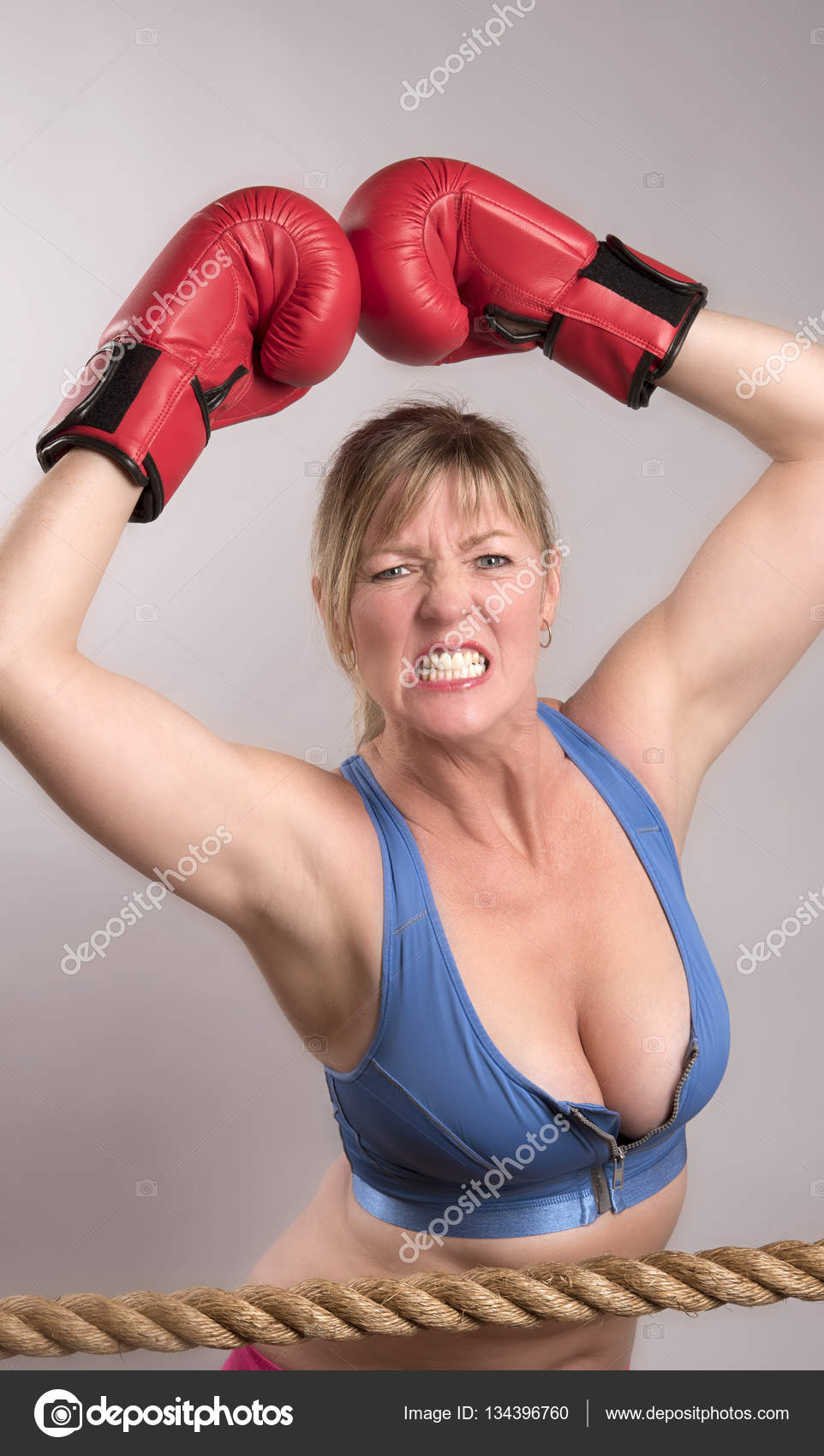 Grimace face clip art stock photo woman pulls a face in upset - Woman Boxer With An Angry Expression On Her Face Stock Image
