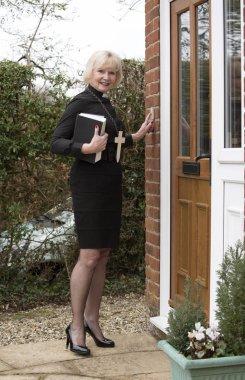 Woman vicar making a house call