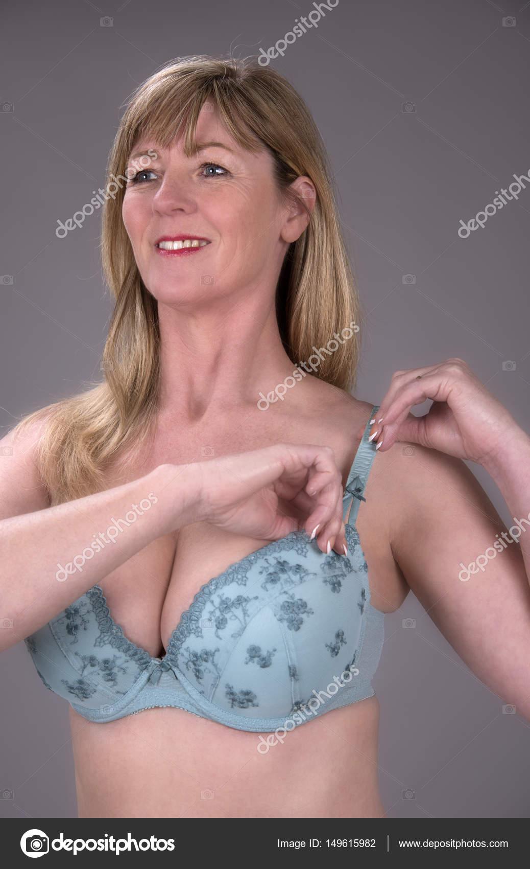 woman adjusting bra