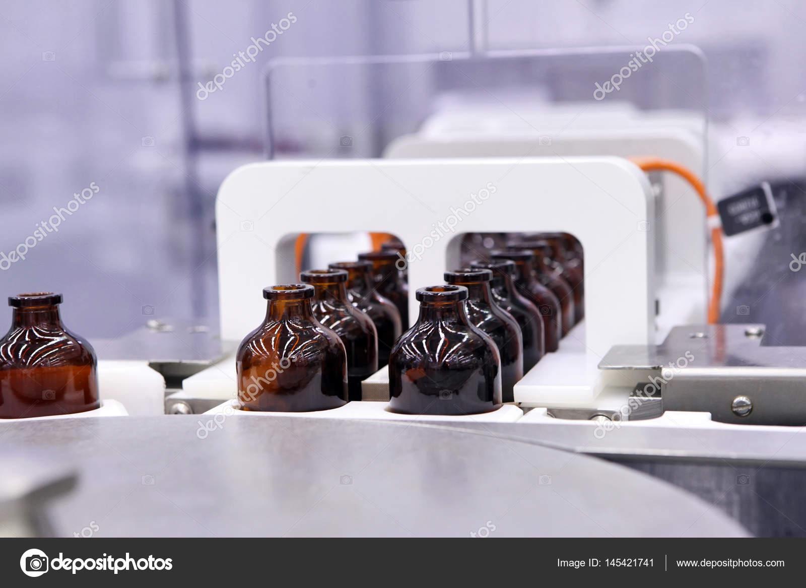 Capsule di sterile per iniezione bottiglie sulla linea di