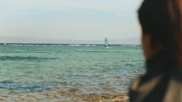 Woman is drinking coffee or tea on the beach with blue sea view, woman look in to horizon, rapid video, slow motion, 4k