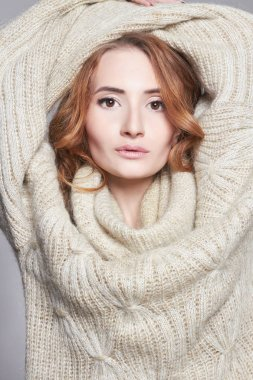 Fashion portrait of winter style beautiful young Woman in fashionable woolen pullover.Girl in sweater stock vector