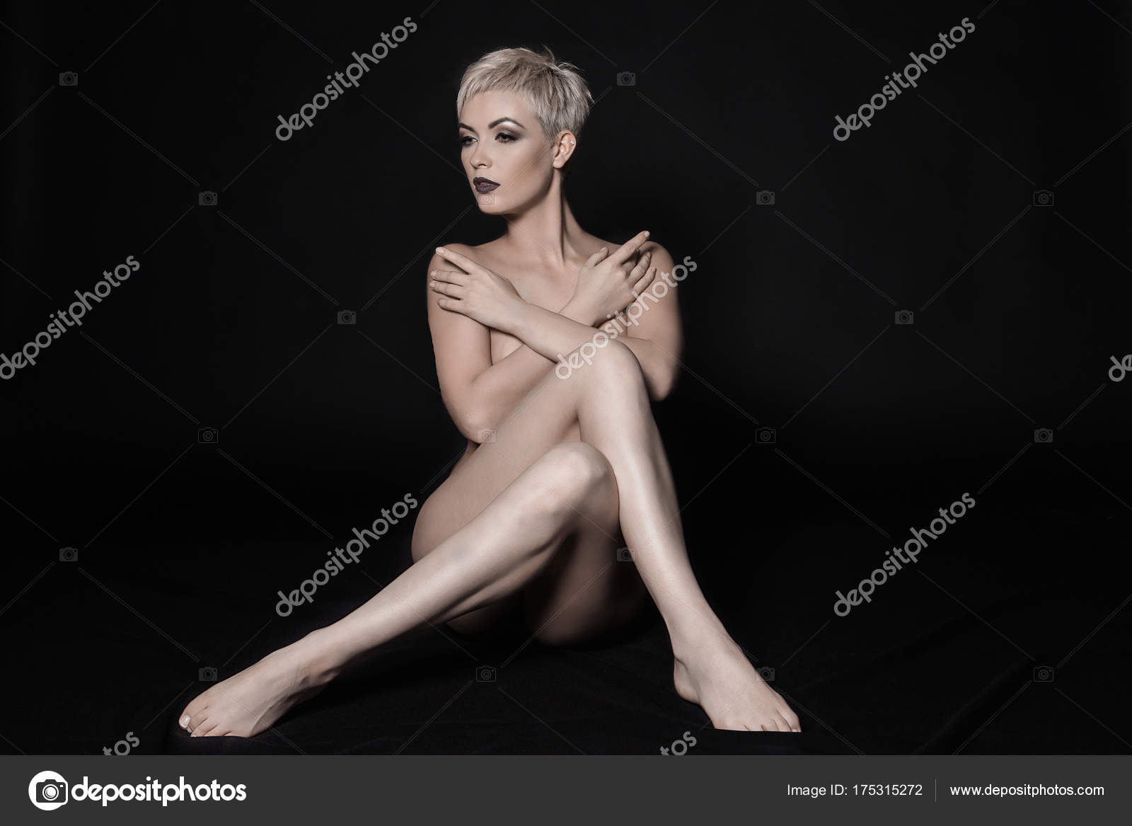 Beautiful nude woman with long legs– stock image