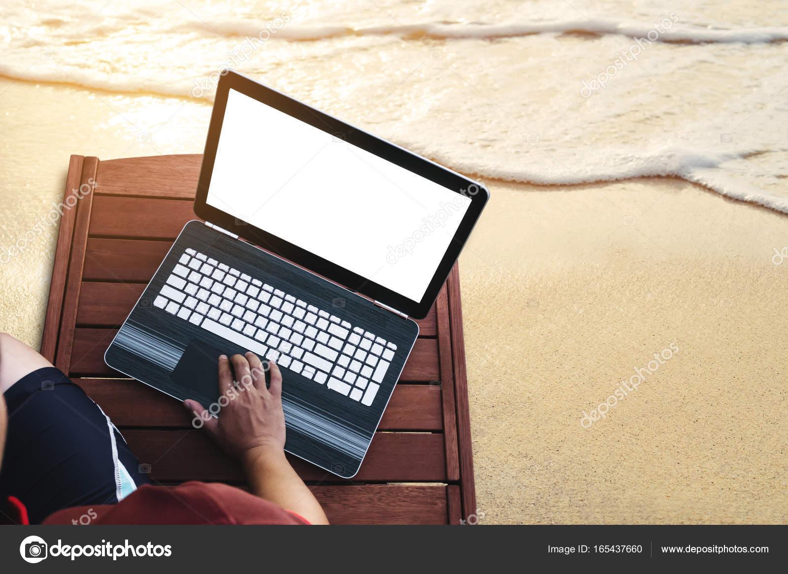 Strange A Man Using Computer Laptop On Wooden Sunbath Lounge Chair Andrewgaddart Wooden Chair Designs For Living Room Andrewgaddartcom