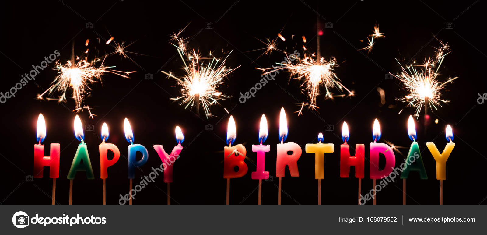 Colorful Happy Birthday Candles With Sparkler Fireworks On Black Background Stock Image