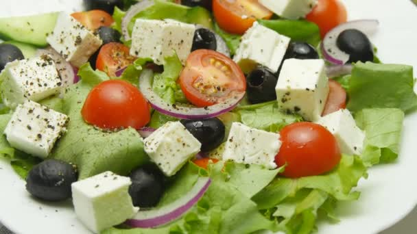 Greek salad with fresh vegetables, feta cheese and black olives rotate