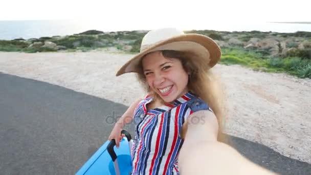 Young woman traveler taking selfie
